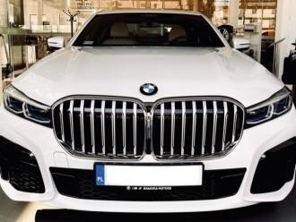 BMW serii 7 Biała perła z białymi skórami . Rok produkcji 2021,  Elbląg